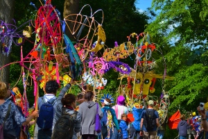 The carnival procession at Larmer Tree Festival near Salisbury