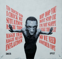 Tricky stencil by Swilfa incorporating broken vinyl and lyrics from Daydreaming