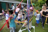 Tony Hiller leads – or loses control of – the maypole dancing